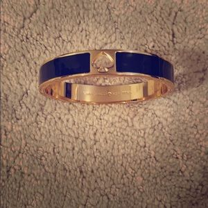 Kate Spade black and gold plated clasp bangle